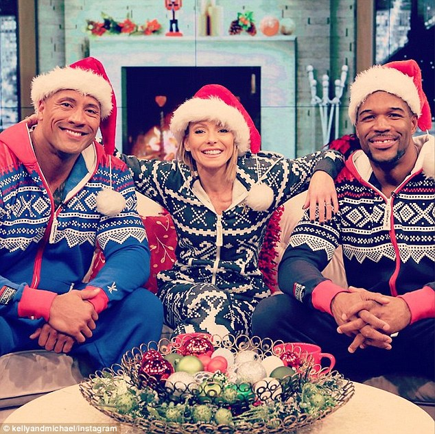 """Watch Dwayne Johnson (The Rock) perform """"Here Comes Santa Clause"""" in a onesie"""